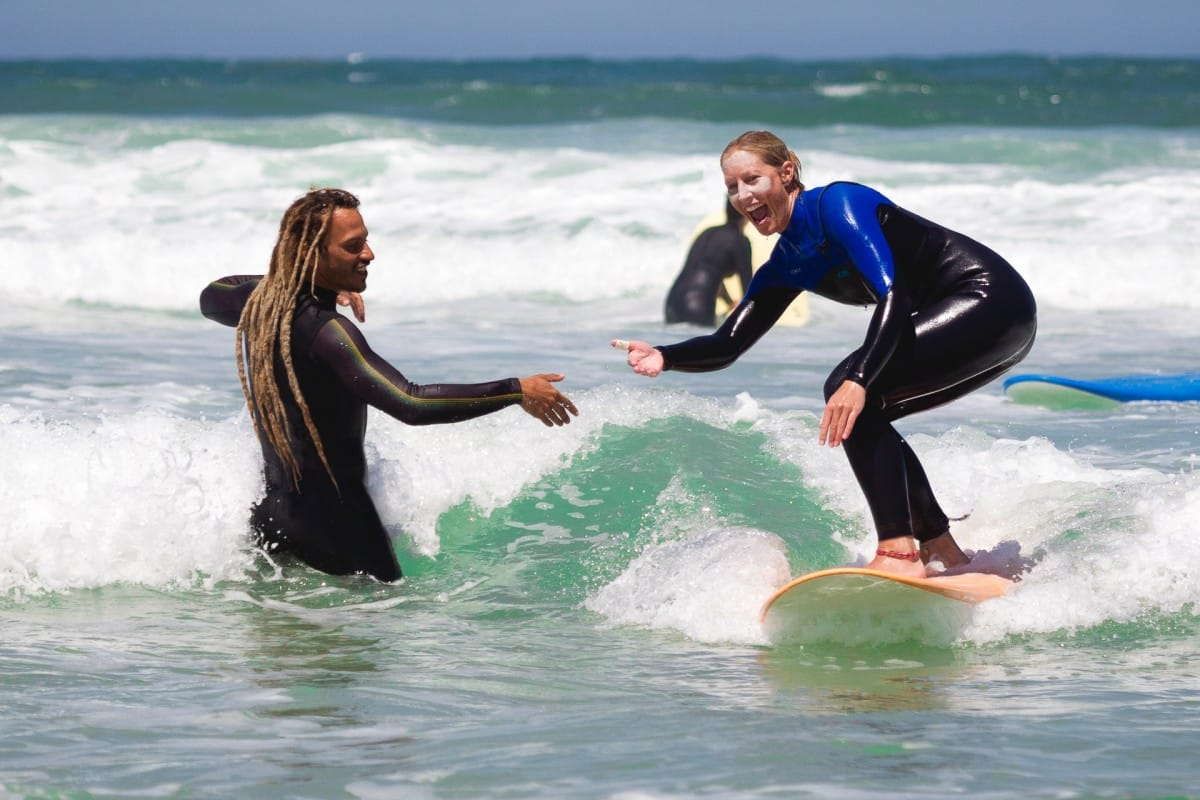 Surfcoach and student